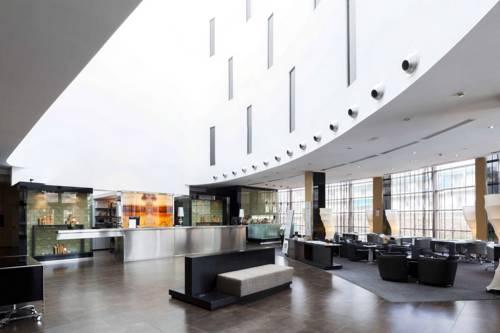 Hol w nowoczesnej aranżacji w ac hotel firenze by marriott