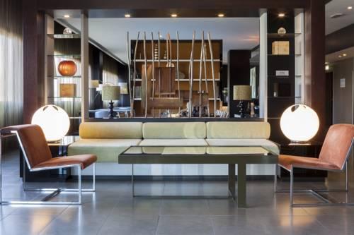 Nowoczesny projekt apartamentu w hotelu AC Hotel by Marriott Pisa, Włochy