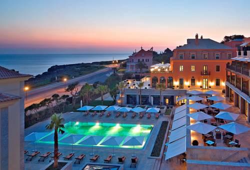 Widok na taras oraz basen w hotelu Grande Real Villa Itália Hotel & Spa, Portugalia
