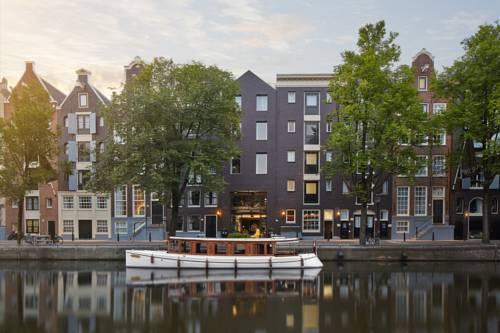 Zdjęcie przedstawiające kamienice w Amsterdamie oraz hotel Pulitzer, Holandia