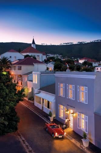 Hotel More Quarters Hotel z podjeżdżającym pod niego kadilakiem, Republika Południowej Afryki