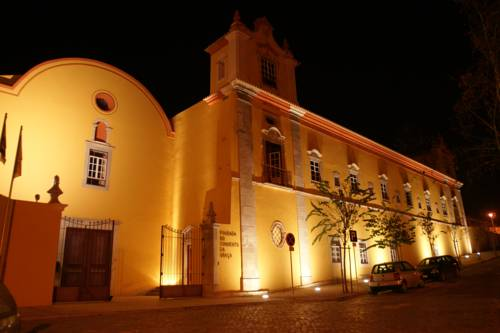 Oświetliny nocą budynek Pousada Convento de Tavira Historic Hotel