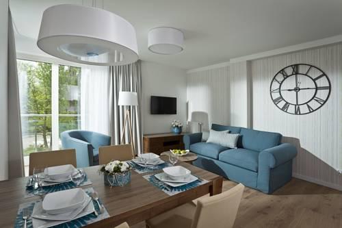 Jadalnia w apartamencie Gwiazda Morza Apart Hotel, Polska