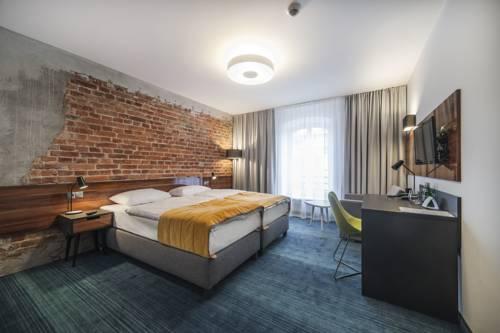Pokój sypialniany w Hotel Tobaco