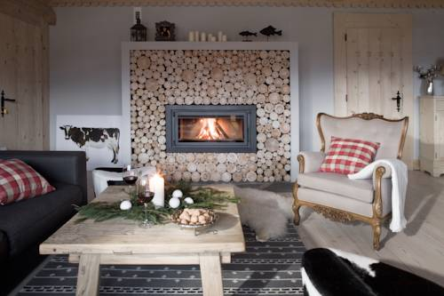 Pokój z kominkiem w Villa Miodula, Koscielisko